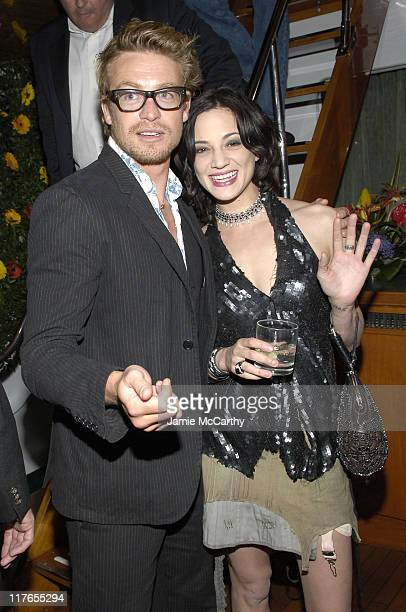 Simon Baker and Asia Argento during 2005 Cannes Fiilm Festival AnheuserBusch Hosts 'Land of the Dead' Party at AnheuserBusch Big Eagle Yacht in...