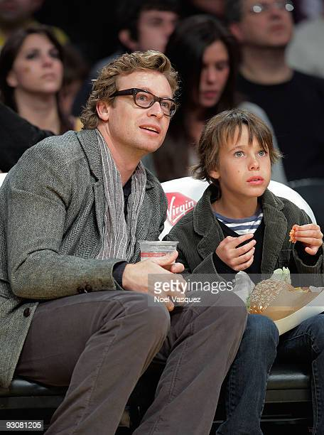 Simon Baker and Claude Blue attend a game between the Houston Rockets and the Los Angeles Lakers at Staples Center on November 15 2009 in Los Angeles...