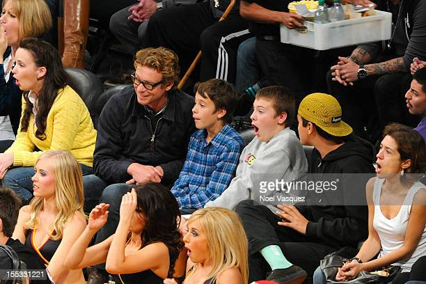 Simon Baker and his son Claude Blue attend a basketball game between the Los Angeles Clippers and the Los Angeles Lakers at Staples Center on...