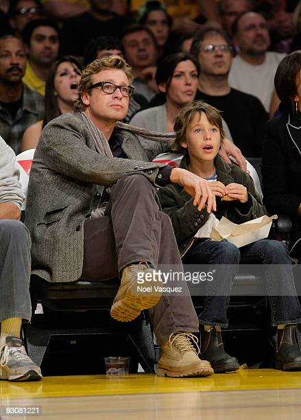 Simon Baker and his son Claude Blue attend a game between the Houston Rockets and the Los Angeles Lakers at Staples Center on November 15 2009 in Los...