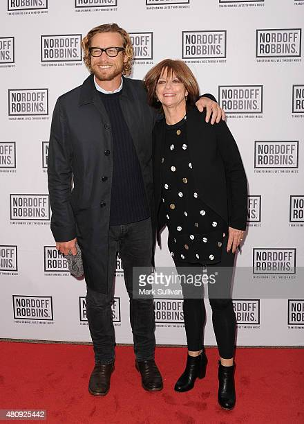 Simon Baker and Jenny Morris arrive at Art of Music Live at Sydney Opera House on July 16 2015 in Sydney Australia