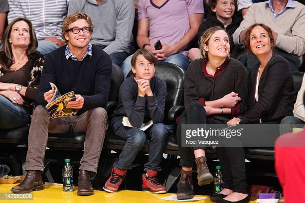 Simon Baker Claude Blu Stella Breeze and Rebecca Rigg attend a basketball game between the Dallas Mavericks and the Los Angeles Lakers at Staples...
