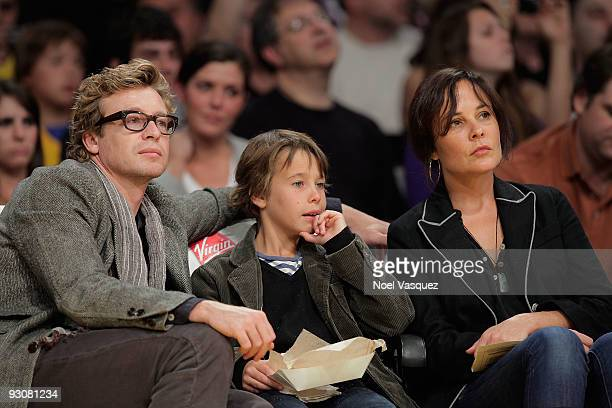 Simon Baker Claude Blue and Rebecca Rigg attend a game between the Houston Rockets and the Los Angeles Lakers at Staples Center on November 15 2009...