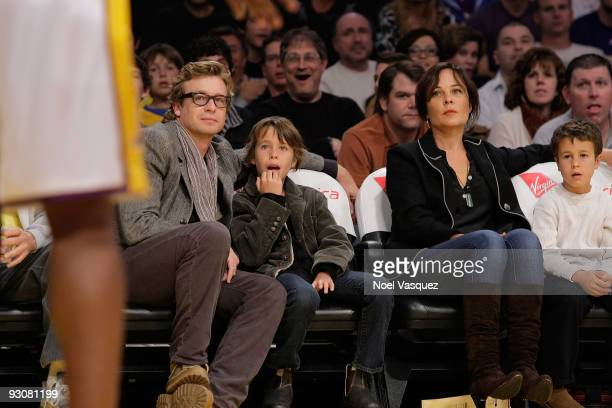 Simon Baker Claude Blue Rebecca Rigg and Harry Friday attend a game between the Houston Rockets and the Los Angeles Lakers at Staples Center on...