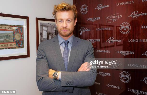 Simon Baker poses at a photocall at Longines boutique to celebrate the Queens Commonwealth Baton arriving in London on August 16, 2017 in London,...