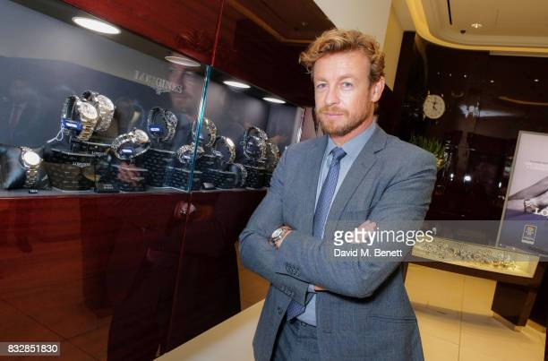 Simon Baker poses at a photocall at Longines boutique to celebrate the Queens Commonwealth Baton arriving in London on August 16 2017 in London...