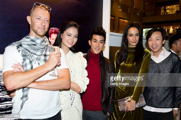 Simon Birch Ana R Aarif Lee Lisa S and unidentified attend the Pringle Of Scotland Hong Kong store opening cocktail party and exhibition at Landmark...