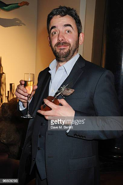 Simon Blackwell with the Best Screenplay Award for 'In The Loop' attends the London Evening Standard British Film Awards 2010 at The London Film...