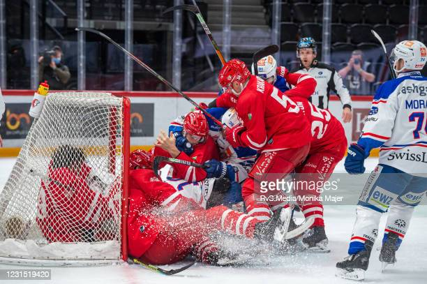 Simon Bodenmann of ZSC Lions fights with Aurelien Marti of Lausanne HC during the Swiss National League game between Lausanne HC and ZSC Lions at...