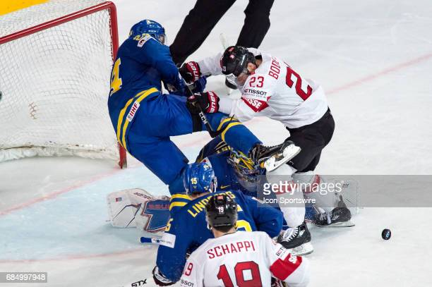 Simon Bodenmann vies with Alexander Edler during the Ice Hockey World Championship Quarterfinal between Switzerland and Sweden at AccorHotels Arena...