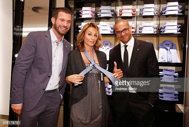 Simon Boeer Caroline Beil and Pierre Geisensetter attend the Pohland store opening on March 12 2014 in Dortmund Germany