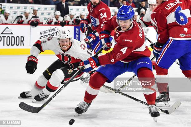 Simon Bourque of the Laval Rocket skates the puck against Jack Rodewald of the Belleville Senators during the AHL game at Place Bell on February 14...