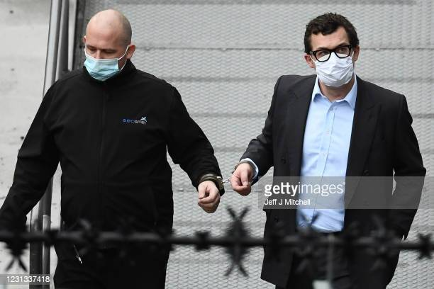 Simon Bowes-Lyon, the the Earl of Strathmore, leaves Dundee Sheriff Court in handcuffs after being sentenced to jail for 10 months for sexually...