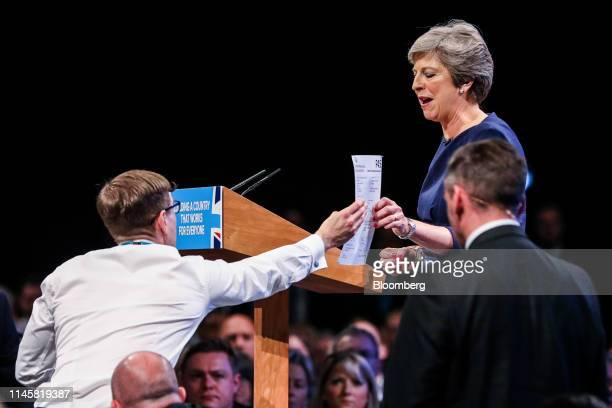Simon Brodkin, comedian, hands Theresa May, U.K. Prime minister and leader of the Conservative Party, a fake P45 tax document given to former...