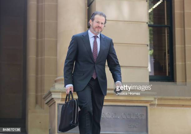 Simon Buchen barrister for Mustapha Dib arrives at Sydney Central Local Court on September 18 2017 in Sydney Australia Michael and Fadi Ibrahim along...