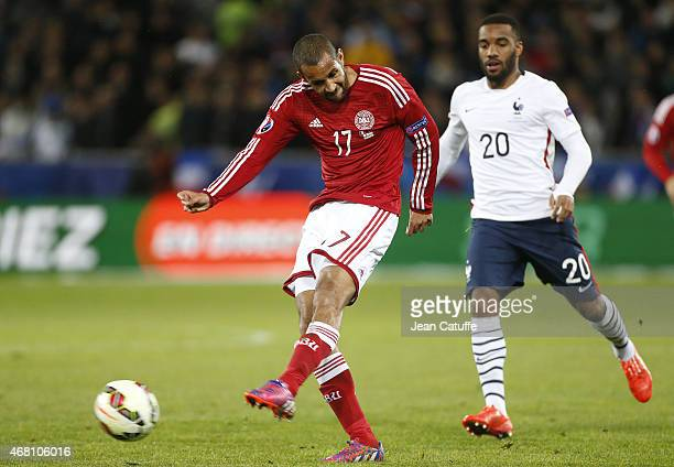 Simon Busk Poulsen of Denmark and Alexandre Lacazette of France in action during the international friendly match between France and Denmark at Stade...