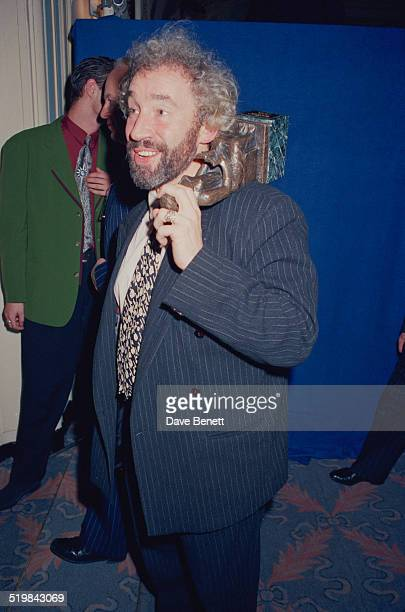 Simon Callow at the Evening Standard Theatre Awards, held at the Savoy Hotel, London, 12th November 1991. He is holding the Ned Sherrin Award for...