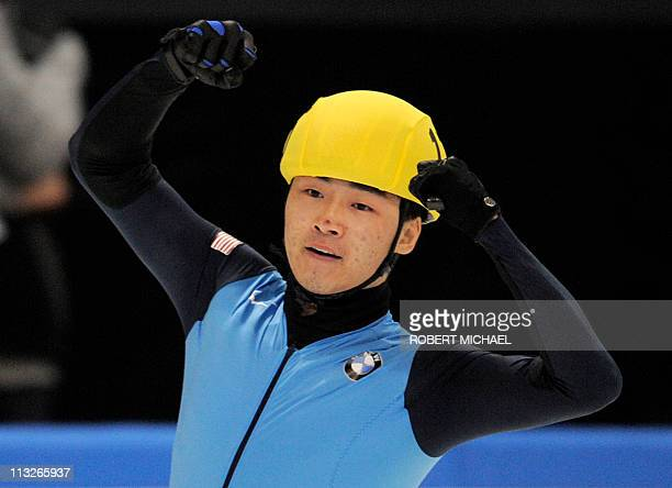 Simon Cho of the US celebrates winning the men's 500m finals of the ISU World Cup short track speed skating final event in Dresden eastern Germany on...