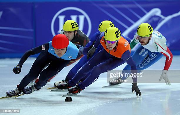 Simon Cho of USA and Sjinkie Knegt of Netherlands lead in the 1000m heats during day three of the ISU World Short Track Speed Skating Championships...