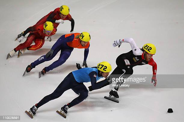 Simon Cho of USA wins gold in the Mens 500m Final as Olivier Jean of Canada wins silver during day two of the ISU World Short Track Speed Skating...