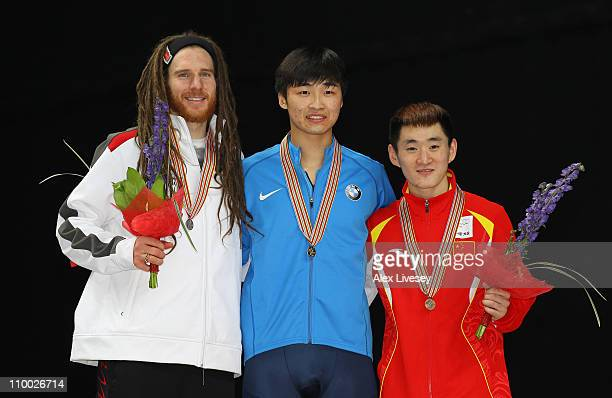 Simon Cho of USA wins gold Olivier Jean of Canada wins silver and Wenhao Liang of China wins bronze in the Mens 500m Final during day two of the ISU...
