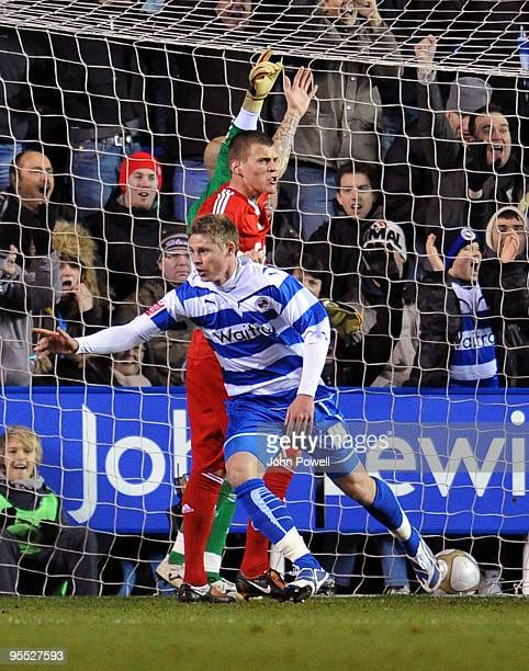 Simon Church of Reading celebrates after scoring a goal against Liverpool during the FA Cup 3rd round match between Reading and Liverpool at the...