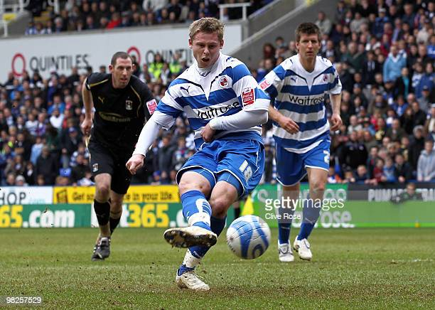Simon Church of Reading scores from the penalty spot during the Coca Cola Championship game between Reading and Coventry City at The Madejski Stadium...