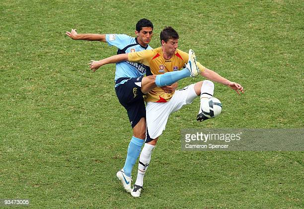 Simon Colosimo of Sydney FC and Michael Bridges of the Jets compete for the ball during the round 16 ALeague match between Sydney FC and the...