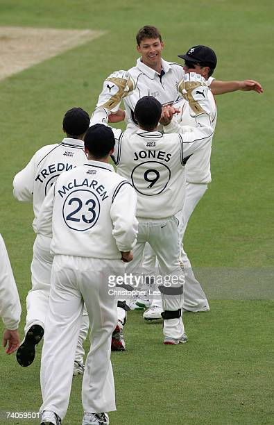 Simon Cook of Kent is hugged by his captain Robert Key as his team mates run to congratulated him on getting the wicket of Matt Prior of Sussex in...