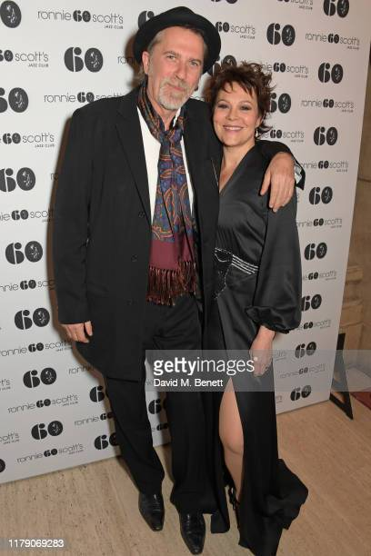 Simon Cooke and Helen McCrory attend A Night At Ronnie Scotts 60th Anniversary Gala at the Royal Albert Hall on October 30 2019 in London England