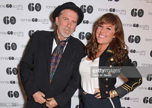 Simon Cooke and Natalie Williams attend A Night At Ronnie Scotts 60th Anniversary Gala at the Royal Albert Hall on October 30 2019 in London England