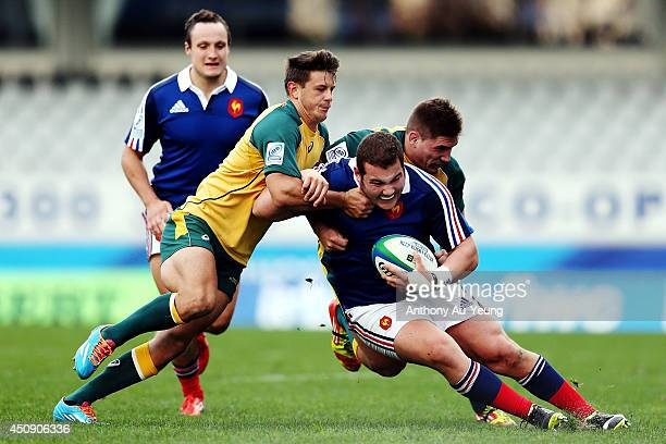 Simon Courcoul of France is tackled by Sean McMahon and Brad Lacey of Australia during the 2014 Junior World Championship 5th Place PlayOff match...