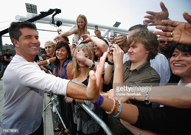 Simon Cowell acknowledges the crowd as he arrives during the first day of auditions for X Factor Series 4 at Arsenal Emirates Stadium on June 9 2007...