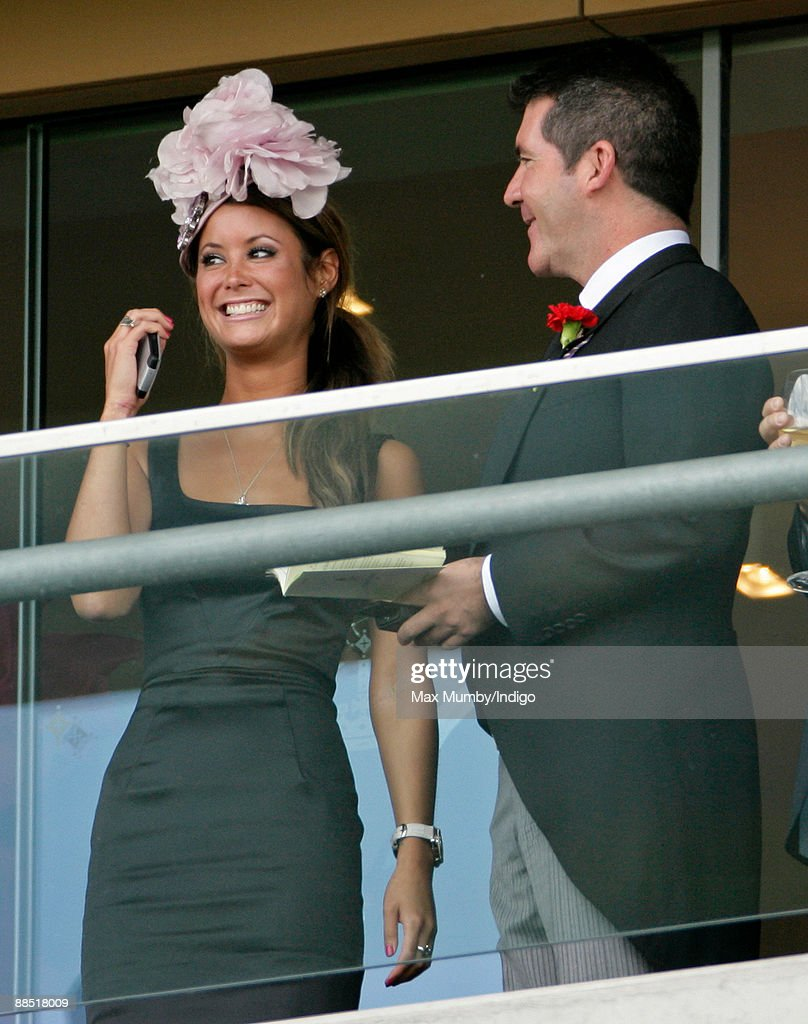 Simon Cowell (right) and a unidentified guest watch the racing from a balcony as they attend Royal Ascot at Ascot Racecourse on June 16, 2009 in Ascot, England.