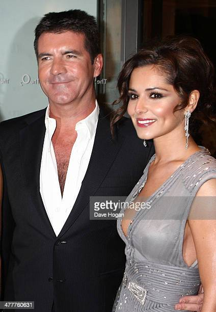Simon Cowell and Cheryl Cole arrive at the National Television Awards held the at The O2 Arena on January 20 2010 in London England Alternate crop of