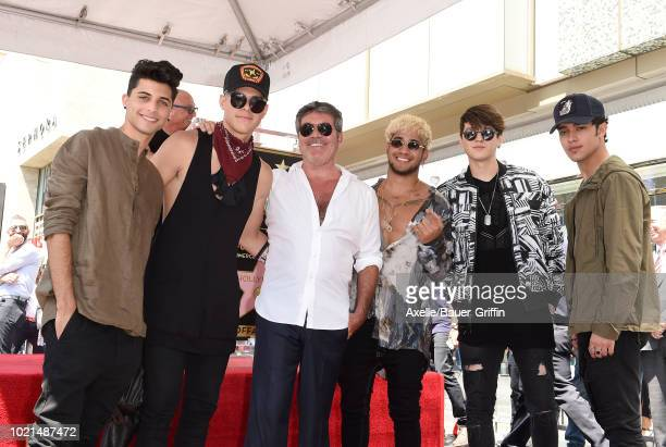Simon Cowell and CNCO attend the ceremony honoring Simon Cowell with star on the Hollywood Walk of Fame on August 22 2018 in Hollywood California