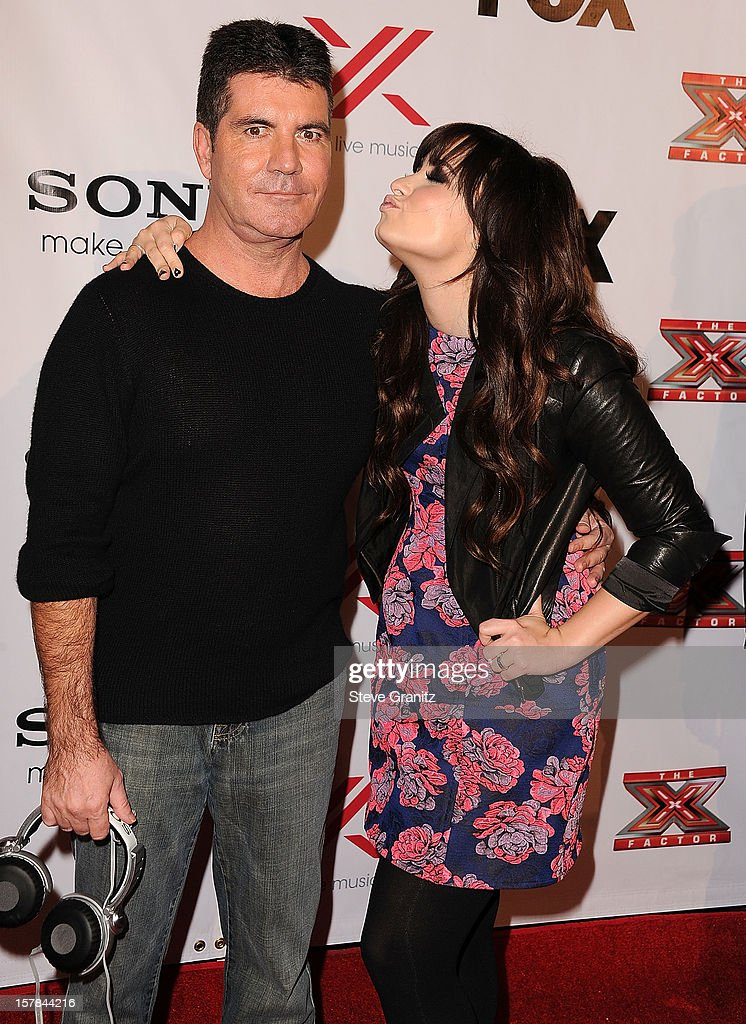 Simon Cowell and Demi Lovato arrives at the 'The X Factor' Viewing Party Sponsored By Sony X Headphones at Mixology101 & Planet Dailies on December 6, 2012 in Los Angeles, California.