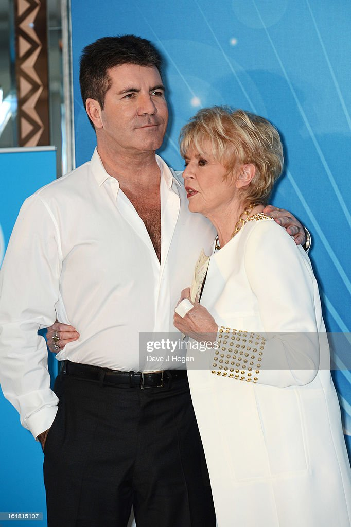 Simon Cowell and Gloria Hunniford attend the Health Lottery champagne tea at Claridges on March 28, 2013 in London, England.