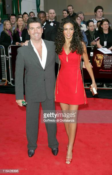 Simon Cowell and Guest during The 2006 British Academy Television Awards - Arrivals at Grosvenor House Hotel in London, Great Britain.