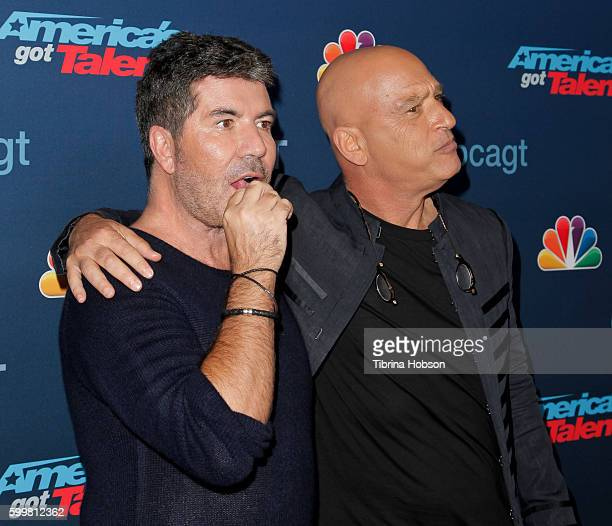 Simon Cowell and Howie Mandel attend the 'America's Got Talent' Season 11 Live Show at Dolby Theatre on September 6, 2016 in Hollywood, California.