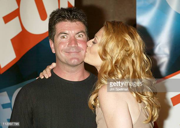 Simon Cowell and Jeri Ryan during 2003-2004 FOX Upfront - After Party at Grand Central Terminal in New York City, New York, United States.