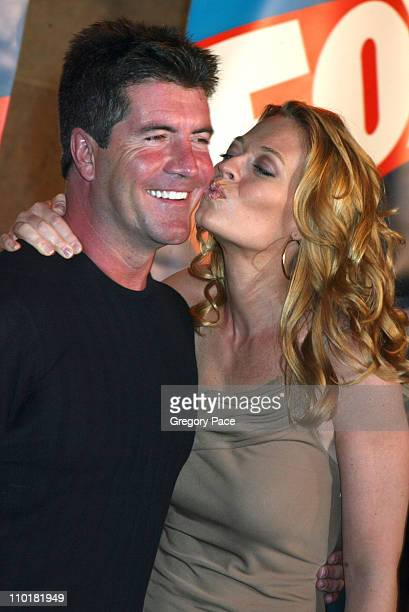 Simon Cowell and Jeri Ryan during FOX TV Network 2003 2004 UpFront Party Arrivals at Ciprianis at Grand Central Station in New York City New York...