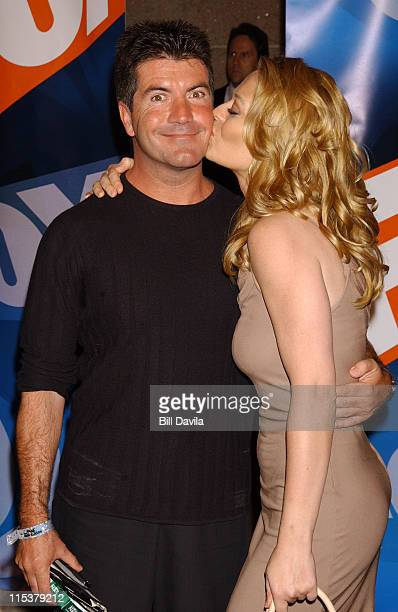 Simon Cowell and Jeri Ryan during FOX TV Network 2003 2004 UpFront Party at Ciprianis at Grand Central Station in New York City New York United States