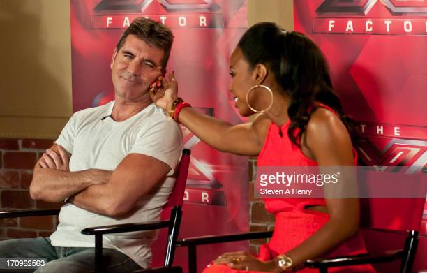 """Simon Cowell and Kelly Rowland attend the """"The X Factor"""" Judges press conference at Nassau Veterans Memorial Coliseum on June 20, 2013 in Uniondale,..."""