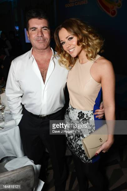 Simon Cowell and Kimberley Walsh attend the Health Lottery champagne tea at Claridges on March 28 2013 in London England