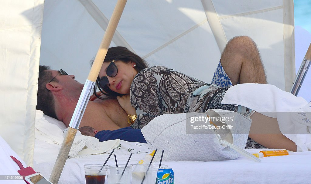 Simon Cowell and Lauren Silverman are seen at the beach on February 23, 2014 in Miami, Florida.