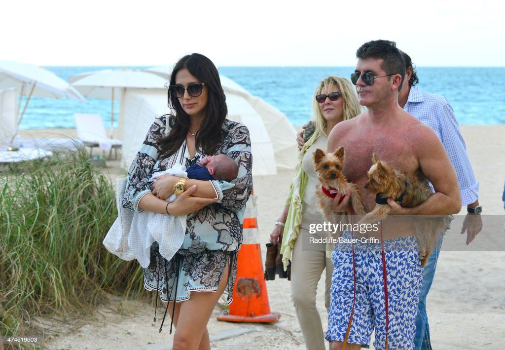 Simon Cowell and Lauren Silverman are seen at the beach with their newborn son Eric Cowell on February 23, 2014 in Miami, Florida.