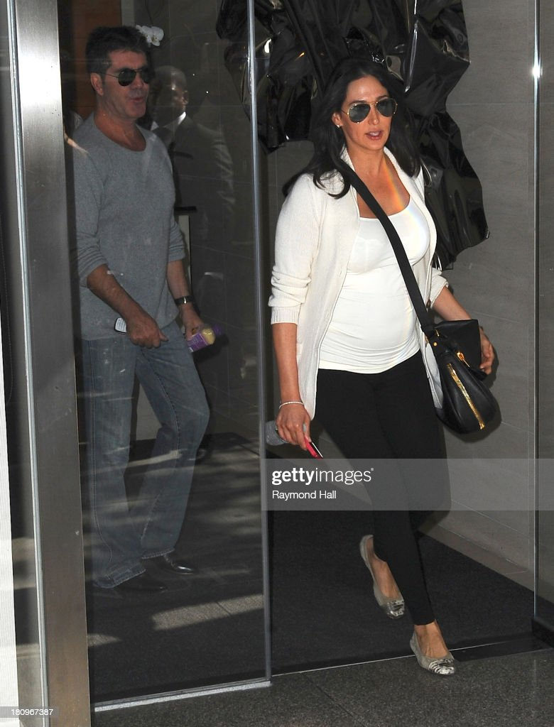 Simon Cowell and Lauren Silverman are seen coming out of a Hotel on September 18, 2013 in New York City.