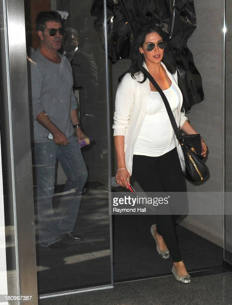 Simon Cowell and Lauren Silverman are seen coming out of a Hotel on September 18 2013 in New York City