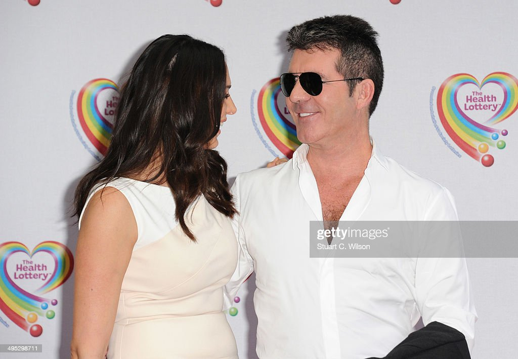 Simon Cowell and Lauren Silverman attend the Health Lottery tea party at The Savoy Hotel on June 2, 2014 in London, England.
